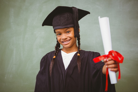 graduation: Portrait of cute little girl in graduation robe holding diploma
