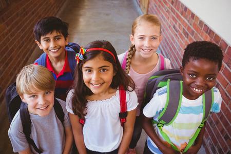 early childhood: Portrait of smiling little school kids in school corridor