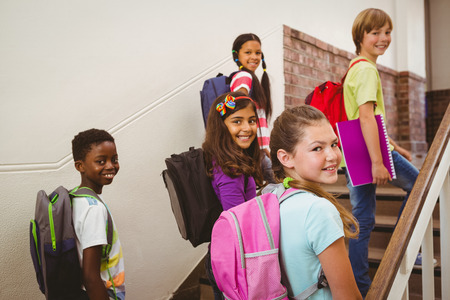 Portrait of children walking up stairs in the school photo