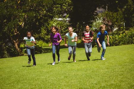 indian girl: Full length of children running at the park