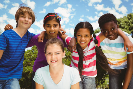 forming: Portrait of happy children forming huddle at the park Stock Photo