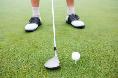 off course: Golfer about to tee off at the golf course
