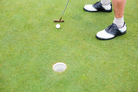 accuracy: Golfer on the putting green at the hole at the golf course Stock Photo