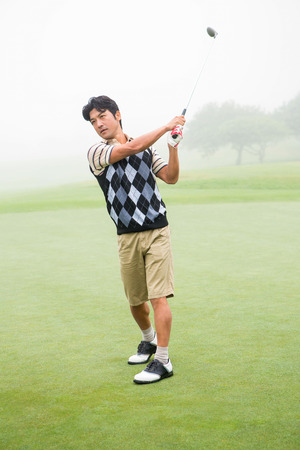 off course: Golfer teeing off the golf course Stock Photo