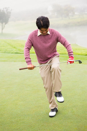 golf glove: Angry golfer trying to brake his club at the golf course