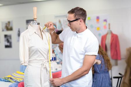Portrait of male fashion designer at work Stock Photo
