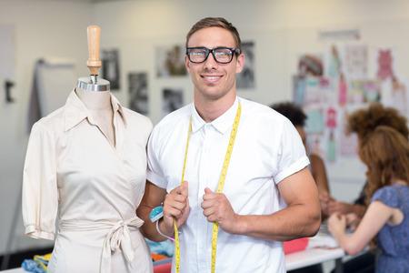 Portrait of confident male fashion designer at work photo