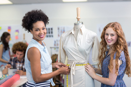 Portrait of female fashion designers at work photo