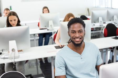 college student: Portrait of smiling students in computer class