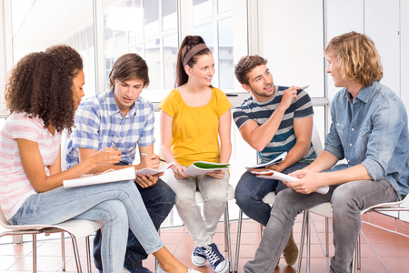 higher intelligence: Group of college students doing homework
