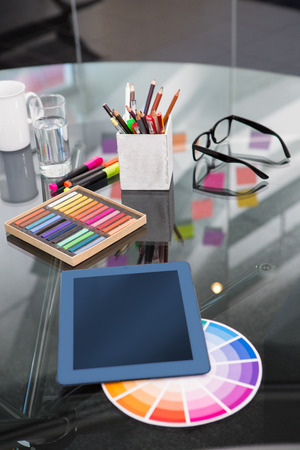 digitizer: Close up of colour samples and digitizer on office desk Stock Photo