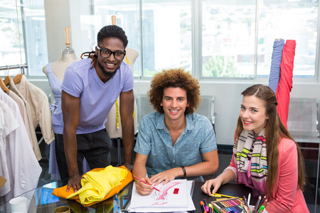 style artistic: Team of young fashion designers sketching at table Stock Photo