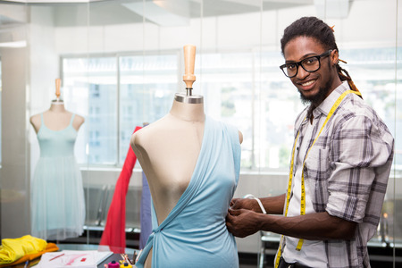 Portrait of male fashion designer and mannequin photo