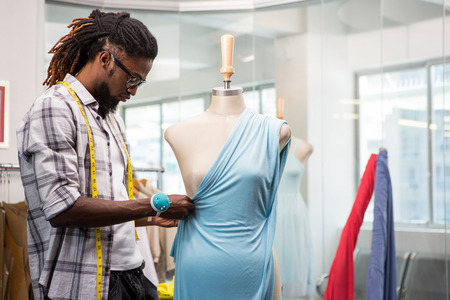 male fashion: Side view of male fashion designer and mannequin Stock Photo