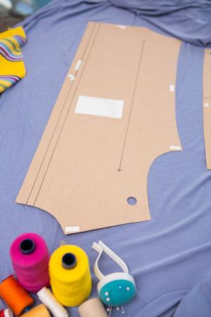 bespoke: Close up of fashion designers table