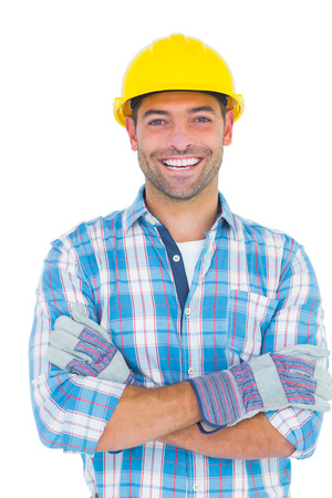 腕と笑顔の肉体労働者の肖像が白い背景の上交差 写真素材