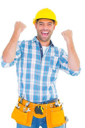 白い背景の上の拳を噛みしめ興奮の肉体労働者の肖像
