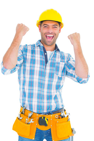 clenching fists: Portrait of excited manual worker clenching fists on white background