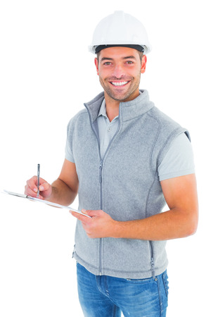 paper work: Portrait of smiling supervisor writing on clipboard on white background