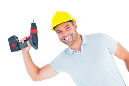 power drill: Portrait of smiling repairman holding power drill on white background