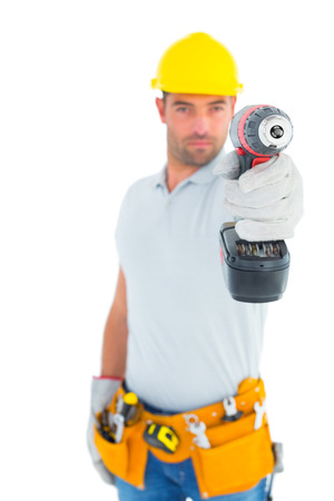 power drill: Portrait of handyman using power drill on white background Stock Photo