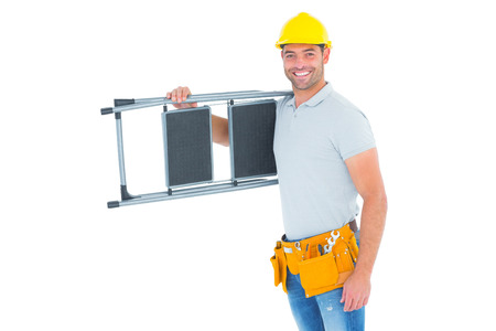 ladder: Portrait of happy manual worker carrying step ladder on white background Stock Photo