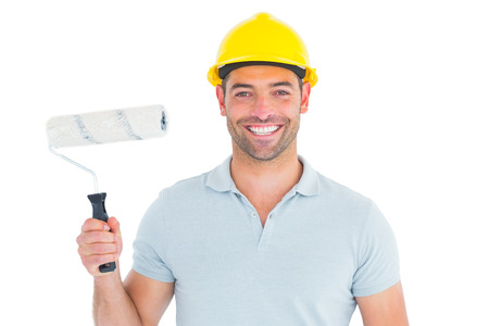 redecorating: Portrait of manual worker holding paint roller on white background