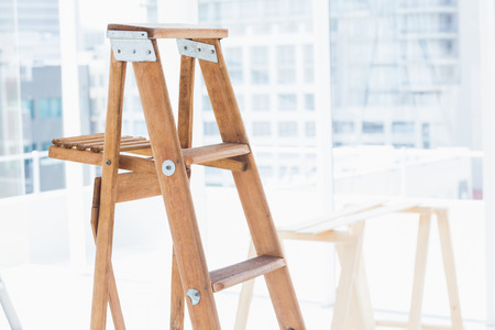 step ladder: Wooden step ladder in bright office