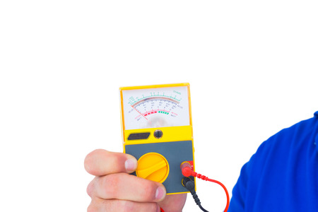 over voltage: Cropped image of electrician holding voltage tester over white background