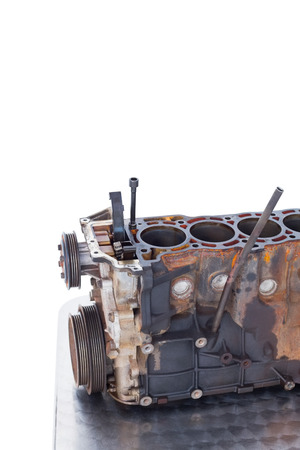 blackout: Close-up of old car engine on white background