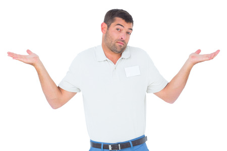 unknowing: Portrait of confused technician giving I dont know gesture on white background