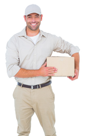 Portrait of happy delivery man with cardboard box on white background Фото со стока