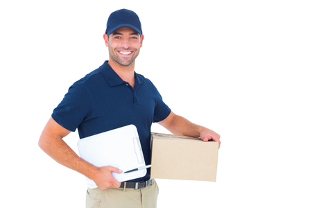 Portrait of happy delivery man with cardboard box and clipboard on white background