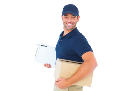 Portrait of smiling delivery man with cardboard box and clipboard on white background Reklamní fotografie - 38186815