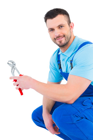 Repairman holding pliers on white background photo