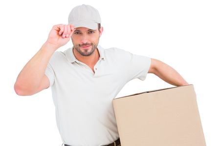 Delivery man with cardboard box wearing cap on white background Reklamní fotografie - 38188540