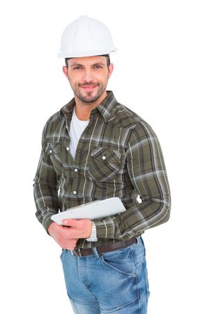 Smiling handyman holding a clipboard over white background photo