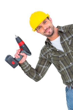 Smiling repairman with drill machine on white background photo