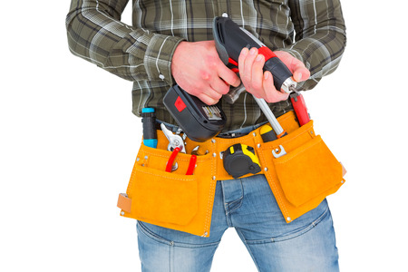 power drill: Manual worker holding gloves and hammer power drill on white background
