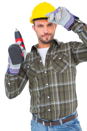 power drill: Handyman holding power drill on white background