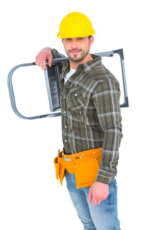 step ladder: Smiling manual worker carrying step ladder on white background Stock Photo