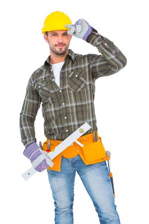 spirit level: Repairman holding spirit level on white background