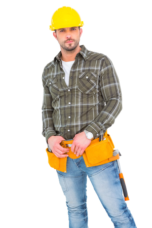 tool belt: Handyman wearing tool belt on white background Stock Photo