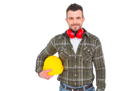 coverings: Handyman with earmuffs holding helmet on white background Stock Photo