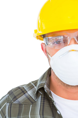 protective work wear: Handyman wearing protective work wear on white background