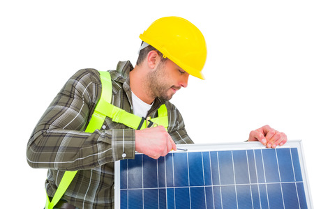 tightening: Manual worker tightening solar panel on white background