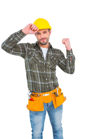 clenching: Smiling manual worker clenching fist on white background