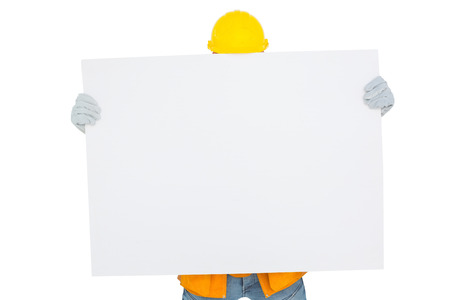 obscured face: Handyman holding blank placard in front of face on white background