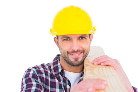 Handyman holding wood planks on white background