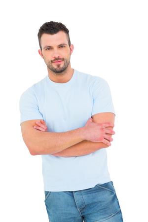 young adult: Handsome man with arms crossed on white background Stock Photo